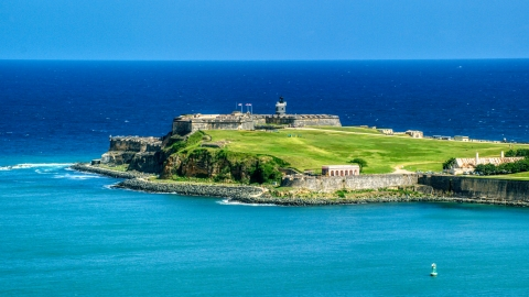 AX101_236.0000000F - Aerial stock photo of Back of the Fort San Felipe del Morro by crystal blue waters, Old San Juan, Puerto Rico