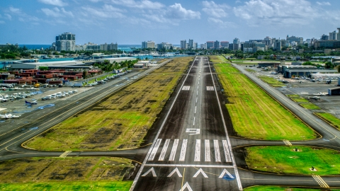 AX101_238.0000000F - Aerial stock photo of The runway of Isla Grande Airport, Puerto Rico