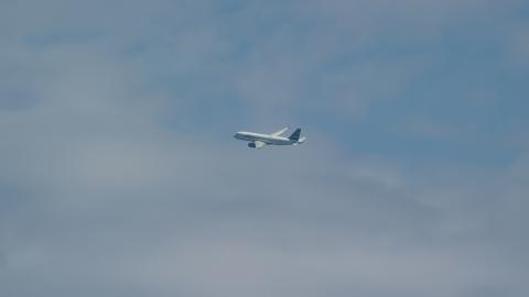 AX102_013.0000134F - Aerial stock photo of A passenger jet flying over Carolina, Puerto Rico
