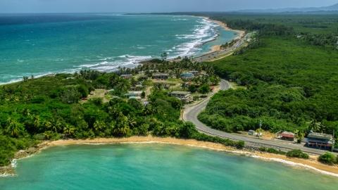 AX102_017.0000095F - Aerial stock photo of Beachfront homes beside a highway, Loiza, Puerto Rico