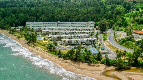 AX102_038.0000207F - Aerial stock photo of Beach and condominium complex in Rio Grande, Puerto Rico
