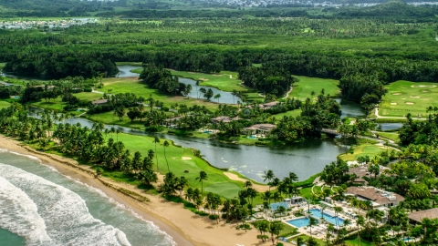 AX102_040.0000127F - Aerial stock photo of Caribbean beachfront resort in Rio Grande, Puerto Rico