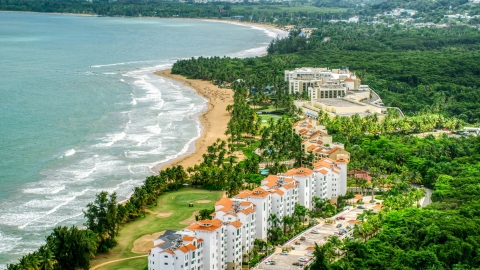 AX102_046.0000145F - Aerial stock photo of Wyndham Grand Rio Mar Beach Resort and Spa in the Caribbean, Rio Grande, Puerto Rico