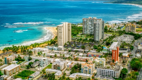 AX102_050.0000000F - Aerial stock photo of Beachfront condominium complexes in Luquillo, Puerto Rico