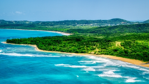 AX102_053.0000000F - Aerial stock photo of Jungle and beach beside clear blue Caribbean waters, Luquillo, Puerto Rico