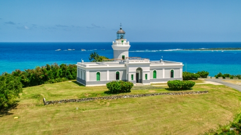AX102_063.0000106F - Aerial stock photo of Cape San Juan Light with a view of crystal blue waters, Puerto Rico