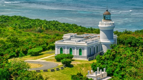 AX102_064.0000000F - Aerial stock photo of The Cape San Juan Light, a Caribbean lighthouse in Puerto Rico