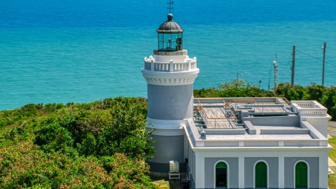 AX102_067.0000000F - Aerial stock photo of The Cape San Juan Light tower with ocean views, Puerto Rico