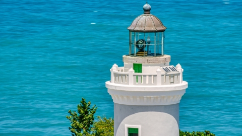 AX102_069.0000175F - Aerial stock photo of The tower of Cape San Juan Light, Puerto Rico