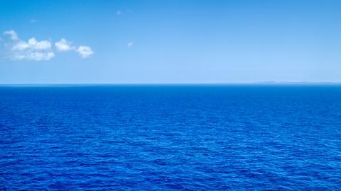 AX102_096.0000000F - Aerial stock photo of Sapphire blue ocean waters of the Atlantic Ocean