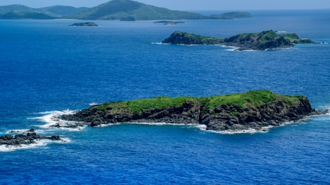 AX102_103.0000000F - Aerial stock photo of Tiny island in crystal blue waters, Culebra, Puerto Rico