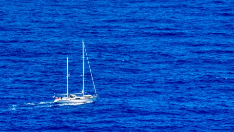 AX102_105.0000100F - Aerial stock photo of Sail boat in sapphire blue waters, Culebra, Puerto Rico