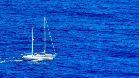 AX102_106.0000000F - Aerial stock photo of Sail boat in sapphire blue waters, Culebra, Puerto Rico