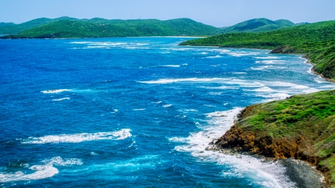 AX102_109.0000094F - Aerial stock photo of Sapphire blue waters by a green island coastline,  Culebra, Puerto Rico