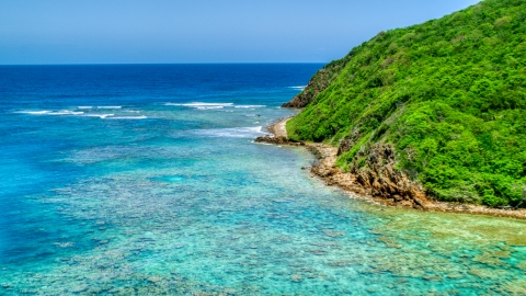 AX102_114.0000000F - Aerial stock photo of Reefs in sapphire blue waters and a rugged coastline, Culebra, Puerto Rico