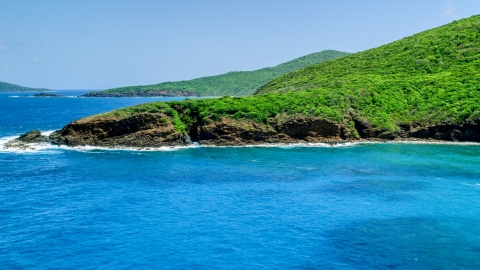 AX102_115.0000000F - Aerial stock photo of Sapphire blue waters and a rugged island coastline, Culebra, Puerto Rico