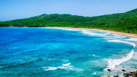 AX102_120.0000121F - Aerial stock photo of Sapphire blue waters and a deserted Caribbean beach in Culebra, Puerto Rico
