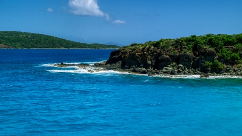 AX102_126.0000000F - Aerial stock photo of Sapphire blue waters and a rugged island coast in Culebra, Puerto Rico