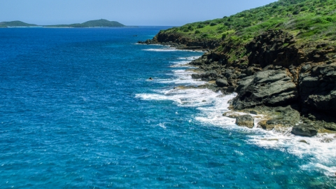 AX102_128.0000116F - Aerial stock photo of Sapphire blue waters and a rugged island coast, Culebra, Puerto Rico