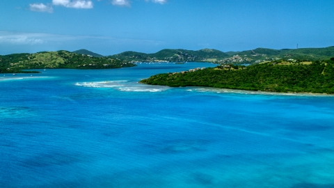 AX102_138.0000238F - Aerial stock photo of Hilltop homes overlooking sapphire blue waters near a coastal town, Culebra, Puerto Rico