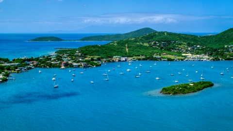AX102_142.0000000F - Aerial stock photo of Sail boats in sapphire blue water near a small coastal town, Culebra, Puerto Rico