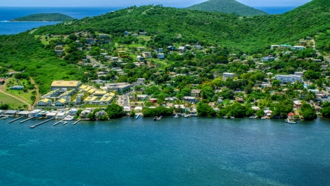 AX102_144.0000000F - Aerial stock photo of Factory and waterfront property in a small town, Culebra, Puerto Rico