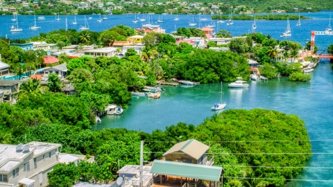AX102_151.0000000F - Aerial stock photo of Boats in a cove at a small oceanside island town, Culebra, Puerto Rico