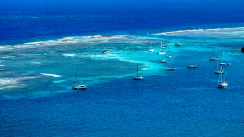 AX102_169.0000000F - Aerial stock photo of Sailboats anchored in the turquoise waters of the harbor, Culebra, Puerto Rico