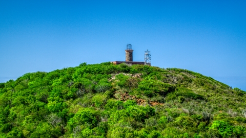 AX102_177.0000274F - Aerial stock photo of The hilltop Culebrita Lighthouse in Puerto Rico