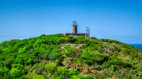 AX102_178.0000000F - Aerial stock photo of The Culebrita Lighthouse on a Caribbean island hilltop, Puerto Rico