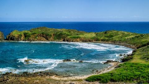 AX102_190.0000096F - Aerial stock photo of Waves rolling in toward the island coast, Culebrita, Puerto Rico