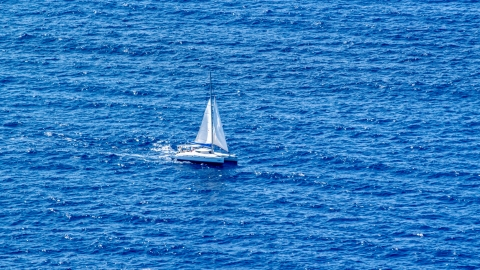 AX102_194.0000157F - Aerial stock photo of Catamaran sailing the Atlantic Ocean