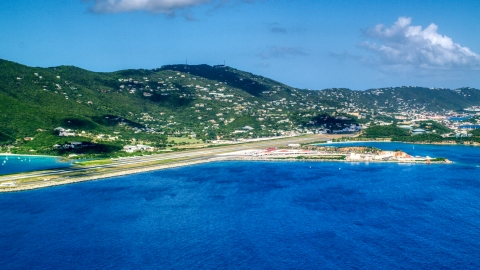 AX102_195.0000000F - Aerial stock photo of Cyril E King Airport and hillside homes on the coast, St. Thomas, US Virgin Islands