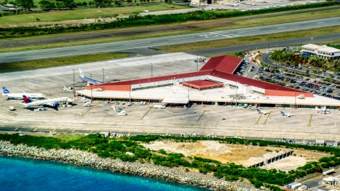 AX102_197.0000000F - Aerial stock photo of The main airport terminal at Cyril E King Airport, St. Thomas, US Virgin Islands