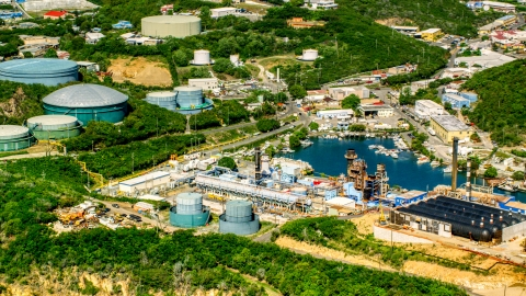 AX102_198.0000000F - Aerial stock photo of Waterfront desalinization plant in Charlotte Amalie, St. Thomas, US Virgin Islands