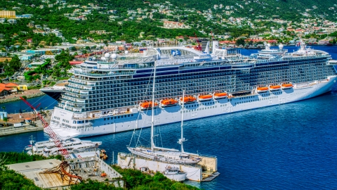 AX102_202.0000435F - Aerial stock photo of Cruise ship docked in Charlotte Amalie, St. Thomas, US Virgin Islands