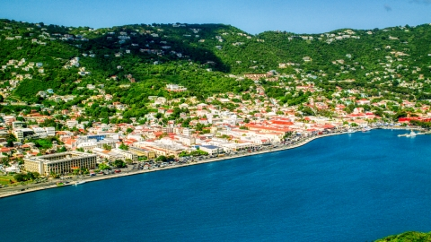 AX102_207.0000000F - Aerial stock photo of Caribbean town and hillsides by sapphire waters, Charlotte Amalie, St. Thomas