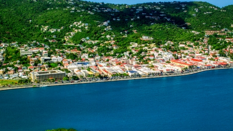 AX102_207.0000263F - Aerial stock photo of Coastal island town beside the harbor, Charlotte Amalie, St. Thomas, US Virgin Islands