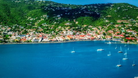 AX102_208.0000276F - Aerial stock photo of Green hills and the island town of Charlotte Amalie, St. Thomas, US Virgin Islands