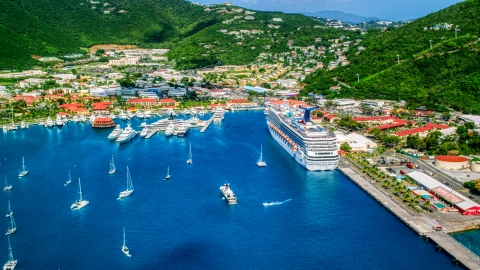 AX102_209.0000086F - Aerial stock photo of Cruise ship and yachts docked at the coastal town of Charlotte Amalie, St. Thomas, US Virgin Islands