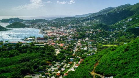 AX102_214.0000000F - Aerial stock photo of Coastal town seen from the hills in Charlotte Amalie, St. Thomas, US Virgin Islands