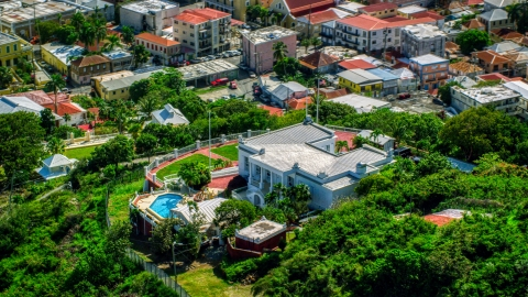 AX102_217.0000076F - Aerial stock photo of The Governor's Mansion in Charlotte Amalie, St Thomas, US Virgin Islands