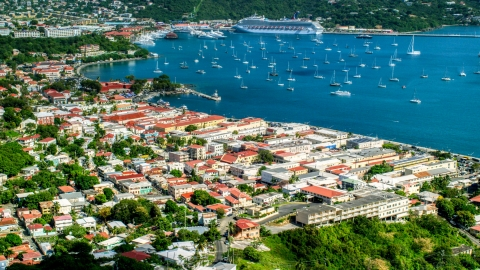 AX102_219.0000000F - Aerial stock photo of Caribbean island town with sailboats in the harbor, Charlotte Amalie, St Thomas