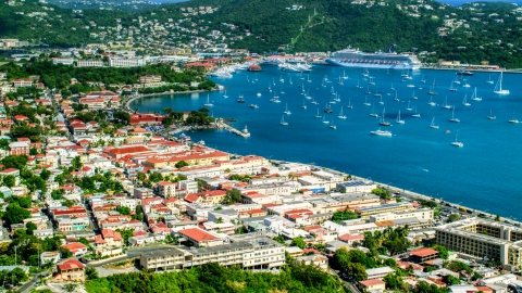 AX102_220.0000000F - Aerial stock photo of Sailboats in the harbor beside the Caribbean island town of Charlotte Amalie, St Thomas
