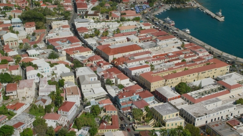 AX102_223.0000000F - Aerial stock photo of Island town buildings by the harbor in Charlotte Amalie, St Thomas, the US Virgin Islands