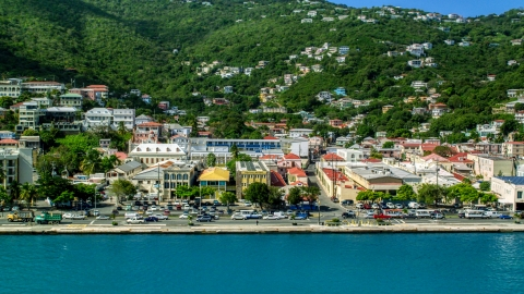 AX102_227.0000253F - Aerial stock photo of Island town buildings on the harbor shore in Charlotte Amalie, St Thomas