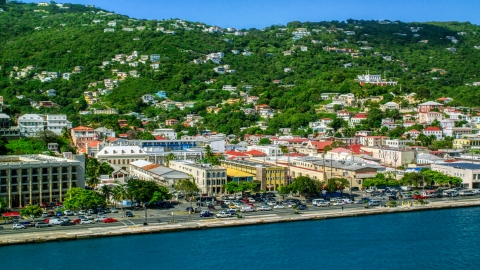 AX102_228.0000000F - Aerial stock photo of Buildings on the harbor shore in the Caribbean island to of Charlotte Amalie, St Thomas, US Virgin Islands