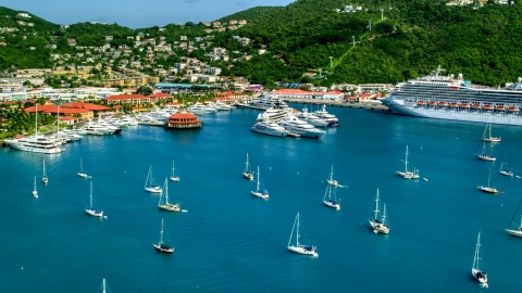 AX102_230.0000193F - Aerial stock photo of Sailboats, yachts, and a cruise ship in sapphire blue waters of the harbor, Charlotte Amalie, St Thomas