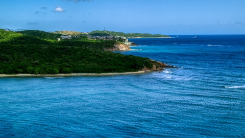 AX102_235.0000000F - Aerial stock photo of Oceanfront condominiums overlooking sapphire blue waters, Southside, St Thomas