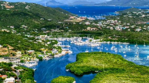 AX102_238.0000000F - Aerial stock photo of Boats docked at a marina in Benner Bay, St Thomas, US Virgin Islands